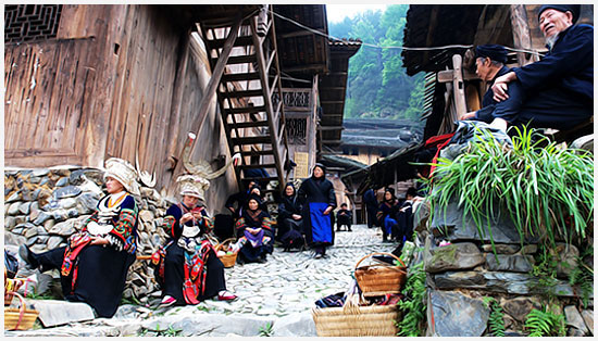 During the festival, the Miao villages sold their handiworks in the village gateway.